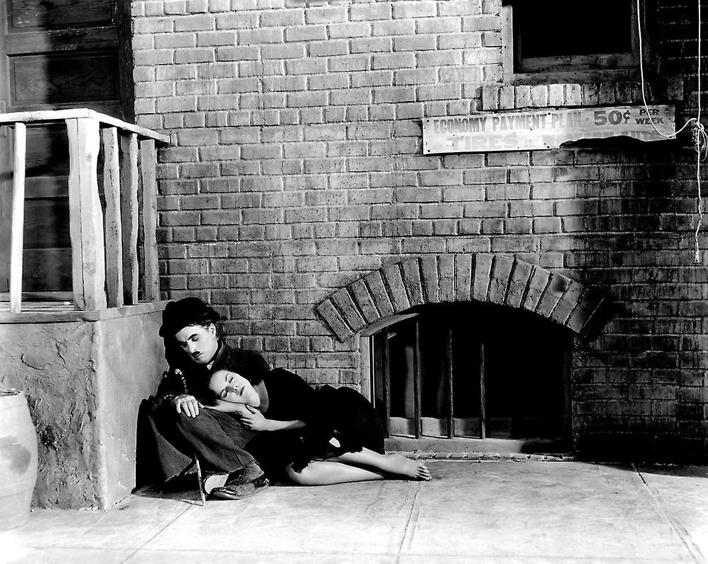 Woman sleeping on Charlie Chaplin's knees
